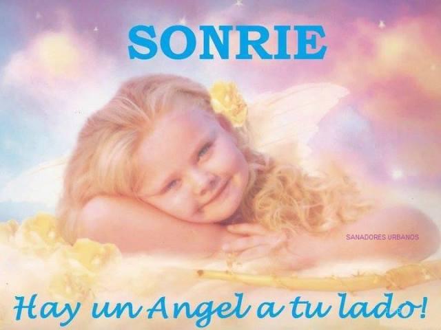 Sonrie tienes a un angel atu lado